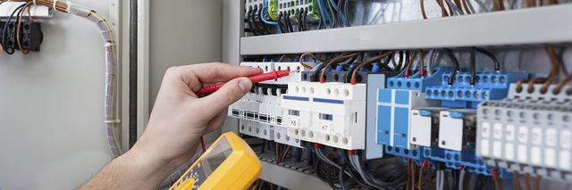 Our residential electricians checking an electrical current in Canberra