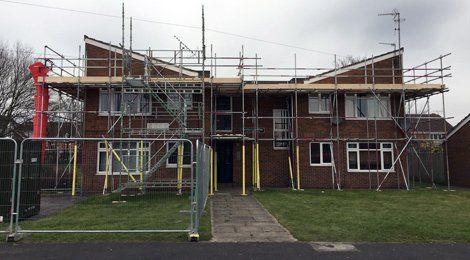 scaffolding around a row of houses
