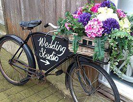 Vintage Butcher's Bike with flowers in a wicker handlebar basket
