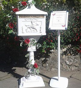 Ivy Rose Post Box adorned with red and white roses