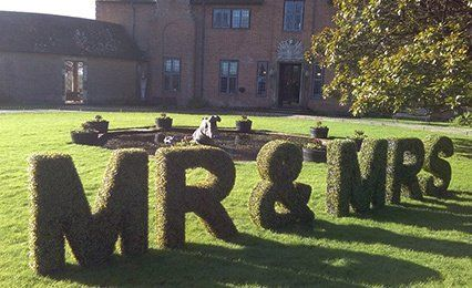 Mr and Mrs sign on garden
