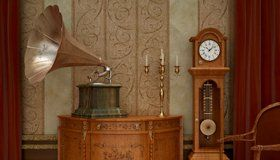 Old fashioned wind up gramophone with horn and grandfather clock by the side