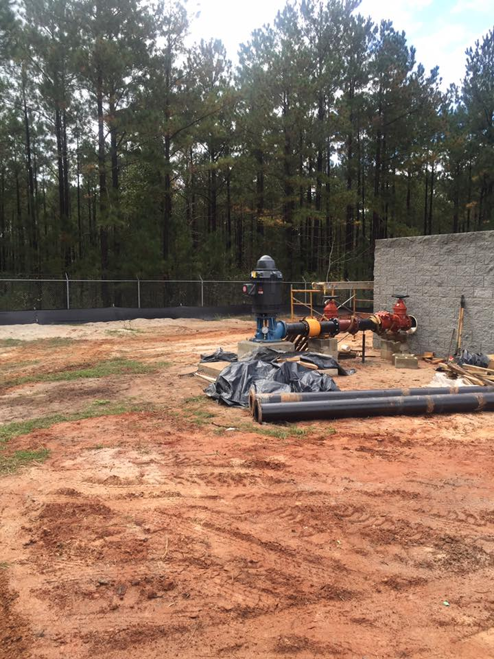 Drilling for geothermal power system in customer's yard by Hammack Well Inc