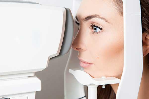 Woman looking at eye test machine