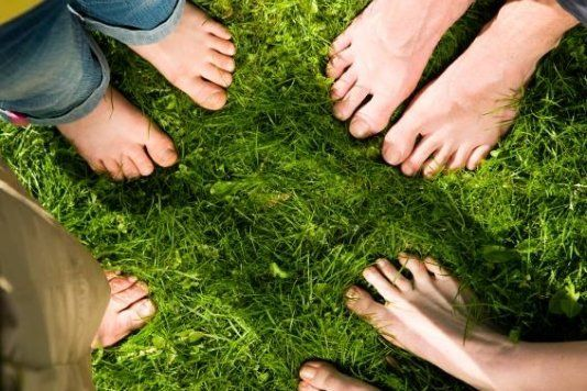 People feet on the grass