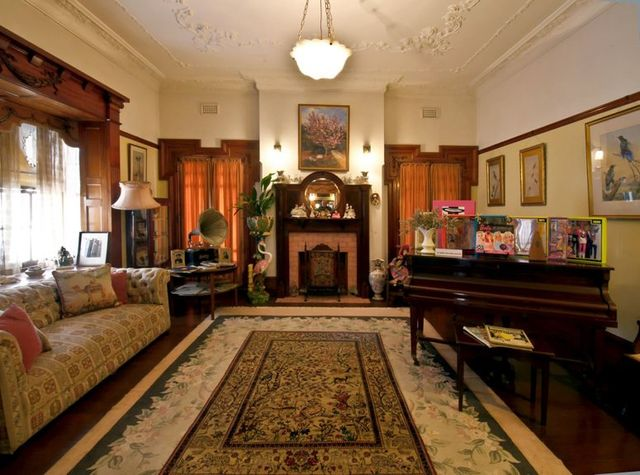 House interior with the paintings of Queen Elizabeth II