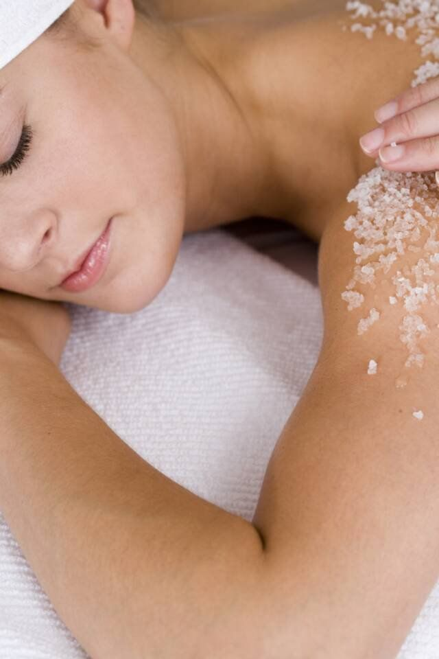Women having sugar scrub treatment