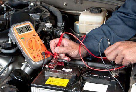 Working on car diagnostics in Douglas