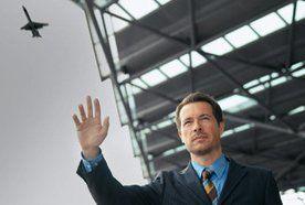a man waving his hand