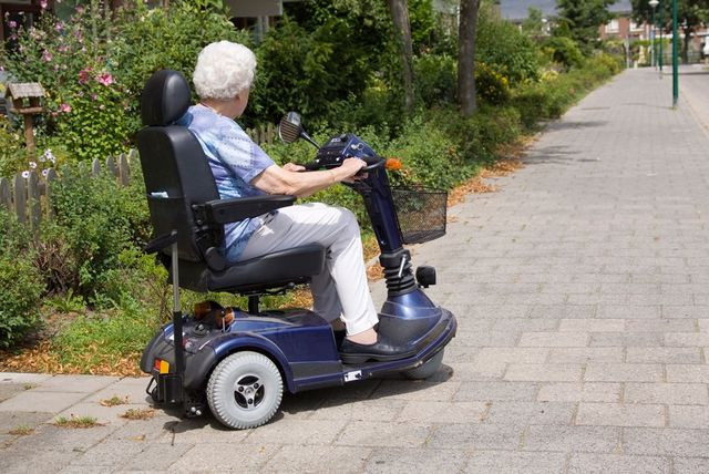 Older woman on a mobility scooter from the mobility experts
