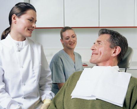 dentist discussing procedure with patient