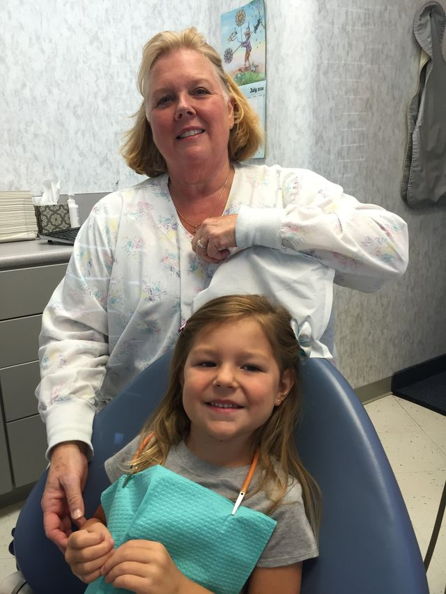 Dentist office employee and child in High Point, NC