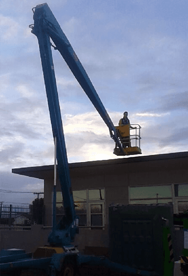Electricians on crane in Auckland