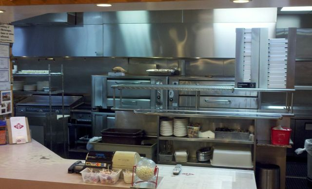 Hope Pizza Restaurant's kitchen where fresh pizza is made in the location of Stamford, CT