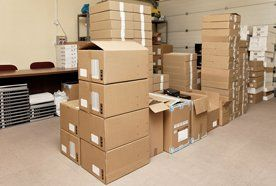 Piles of packing boxes in a room