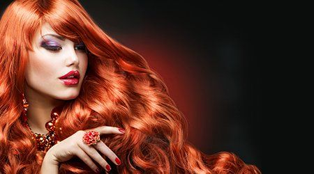A woman with long flowing red hair