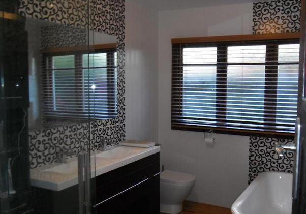 Bathroom with ceramic tiles on the floor and walls