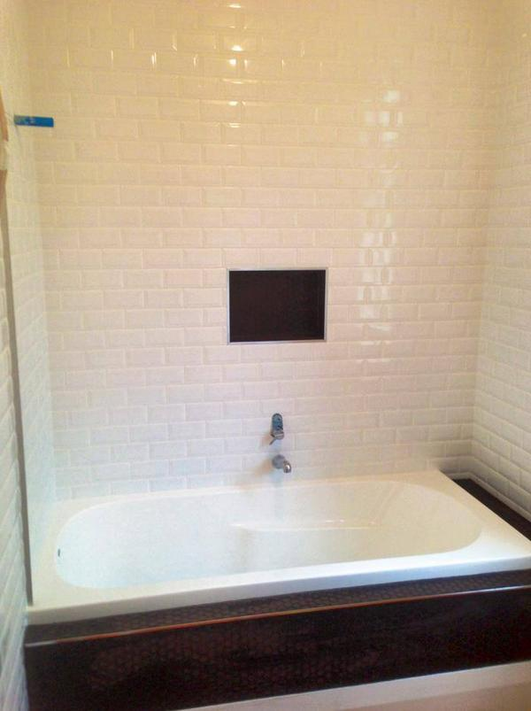 Bathroom white ceramic tiling in Auckland by A1 Surface Tiling