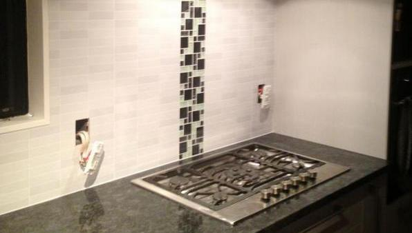 Kitchen splashback with integrated grouted tiles in Auckland by A1 Surface Tiling