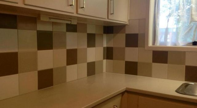 Kitchen splashback with tiles in Auckland by A1 Surface Tiling