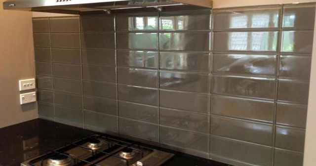Kitchen splashback grouted with tiles in Auckland by A1 Surface Tiling