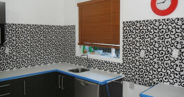 Kitchen splashback and walls with mosaic tiles in Auckland