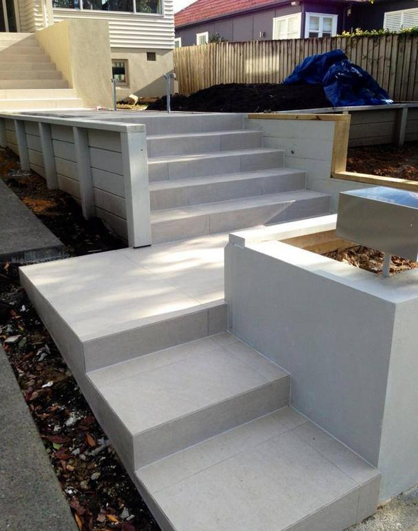 Outdoor tiled steps at Howick residence in Auckland by A1 Surface Tiling