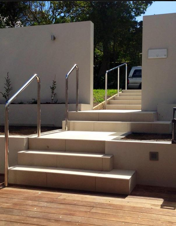 Outdoor tiled steps with railing in Auckland