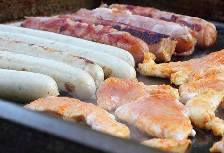 Pork sausages being fried