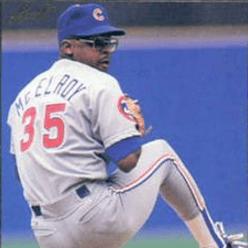 Baseball player pitching the baseball.