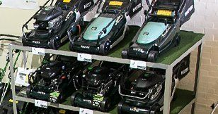 Walkbehind mowers on a shelf