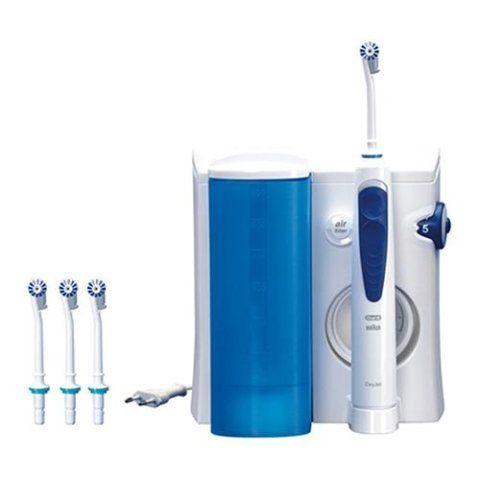 un dispositivo con uno spazzolino elettrico e dell'acqua purificata