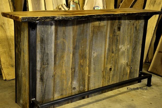 Home bar made with barn board, industrial steel and a natural bark edge top.