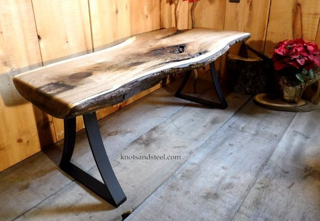 Live edge small coffee table with bent steel legs.