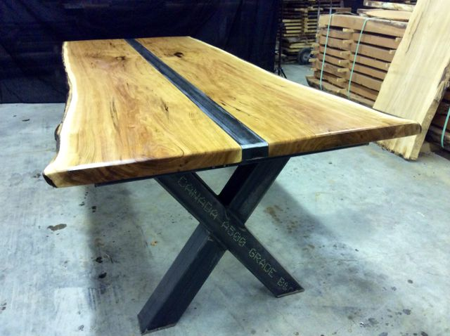 Custom made industrial style dinning table with live edge wood slabs.