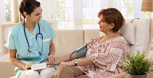 Nurse measuring blood pressure of patient