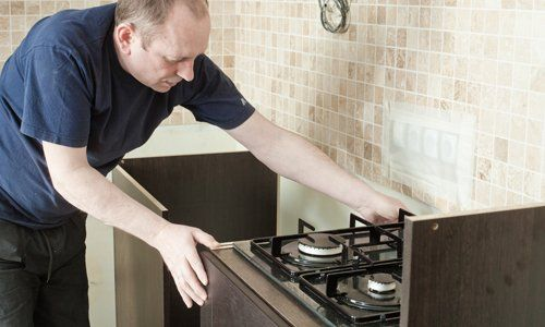 Professional providing kitchen remodeling services in Lewisburg, PA