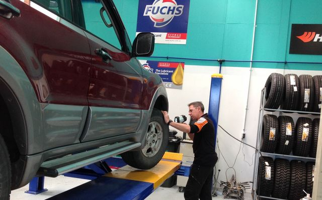 A mechanic providing auto repairs on a car in Nelson