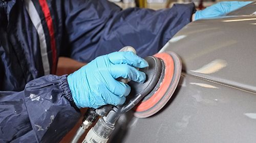 Professional repairing an automobile in Goshen, NY