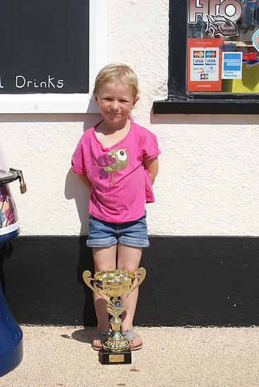 Little kid with trophy