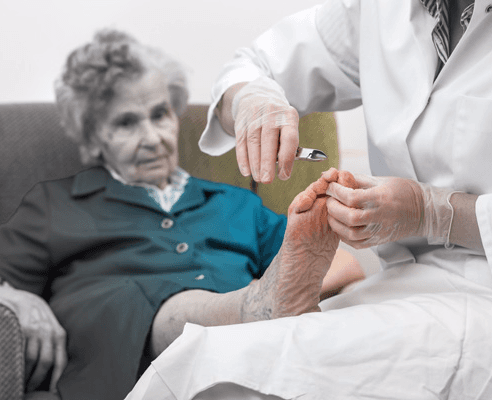 Foot Medic doctor visiting a patient at their house for a checkup