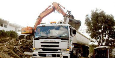 excavator and truck during demolition