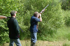 students practicing shooting