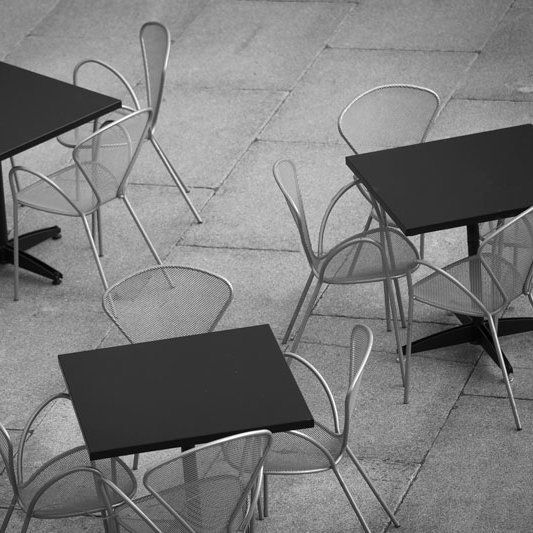 Tables and chairs on a concrete seating area in Penrith