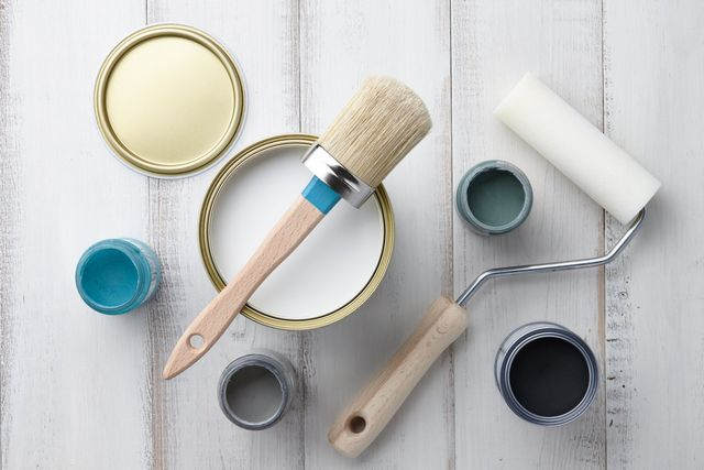 Home U2014 Paint Brush, Sponge Roller And Other Painting Or Decorating Supplies  On White Wooden