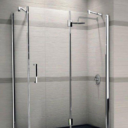 un box doccia e dei muri con delle piastrelle di color grigio
