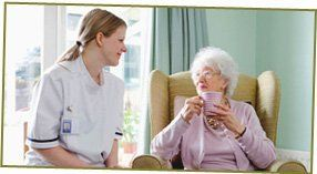 Care home - Hanbury - Far Fillimore Rest Home - old woman and nurse