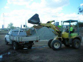 apollo landscaping mini loader on site