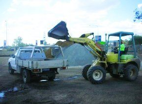bulldozer loading up ute