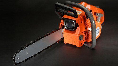 An orange electric saw
